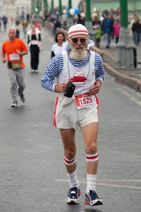 Moscow, Russia, 12/09/2010. An elderly runner makes his way across a bridge during the 30th annual Moscow International Marathon.